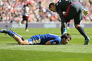 Leicester City forward Shinji Okazaki (20)  felt the challenge during the Barclays Premier League match between Sunderland and Leicester City at the Stadium Of Light, Sunderland, England on 10 April 2016. Photo by Simon Davies.