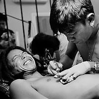 Bangkok Ffebruary 2010, Thai master tattoo artist Neng tattoo a Japanese tourist at his studio in Bangkok.