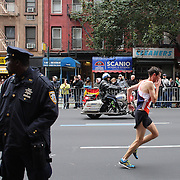 A strong police presence as runners make their way along First Avenue in Manhattan, New York, during the ING New York Marathon. New York, USA. 3rd November 2013. Photo Tim Clayton