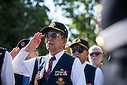 Veterans salute during the City of Milpitas Memorial Day ceremony at Milpitas City Hall in Milpitas, California, on May 30, 2016. (Stan Olszewski/SOSKIphoto)