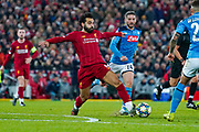 Liverpool forward Mohamed Salah (11) and Napoli forward Dries Mertens (14) in action during the Champions League match between Liverpool and Napoli at Anfield, Liverpool, England on 27 November 2019.