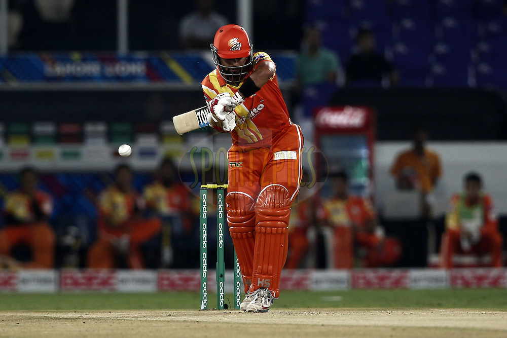 Ahmed Shehzad of the LAHORE LIONS bats during match 7 of the Oppo Champions League Twenty20 between the Kolkata Knight Riders and the Lahore Lions held at the Rajiv Gandhi Cricket Stadium, Hyderabad, India on the 21st September 2014<br /> <br /> Photo by:  Deepak Malik / Sportzpics/ CLT20<br /> <br /> <br /> Image use is subject to the terms and conditions as laid out by the BCCI/ CLT20.  The terms and conditions can be downloaded here:<br /> <br /> http://sportzpics.photoshelter.com/gallery/CLT20-Image-Terms-and-Conditions-2014/G0000IfNJn535VPU/C0000QhhKadWcjYs