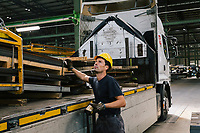 SANTA MARIA DEGLI ANGELI (ASSISI), ITALY - 11 JUNE 2018: A worker moves steel sheets with a magnet towards a truck at the  IRON S.p.A. factory, a publicly traded company that makes industrial steel parts, in Santa Maria degli Angeli (Assisi), Italy, on June 11th 2018.<br /> <br /> President Donald Trump's administration plans to impose tariffs on European steel and aluminum imports after failing to win concessions from the European Union, a move that could provoke retaliatory tariffs and inflame trans-Atlantic trade tensions. Until the moment that the American president rendered his decision, Mr. Capponi, the commercial director of IRON spa, was confident the continent would be spared.<br /> Given that IRON is a purchaser of steel, the company might benefit from the American tariffs. Steel now shipped to the United States from mills within Europe might stay here to avoid the tariffs, raising the supply and dropping prices. Chinese producers who export to American shores could divert their product to Europe, amplifying this trend.<br /> But Mr. Capponi was banking on none of this. Even if steel prices decline, his customers are likely to squeeze him for lower prices. More broadly, the American tariffs — justified by the Trump administration as a supposed defense of national security — reverberated as a blow against world trade.