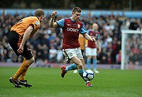 James Milner<br /> Aston Villa 2009/10<br /> Jody Craddock Wolverhampton Wanderers<br /> Aston Villa V Wolverhampton Wanderers (2-2) 20/03/10<br /> The Premier League<br /> Photo Robin Parker Fotosports International