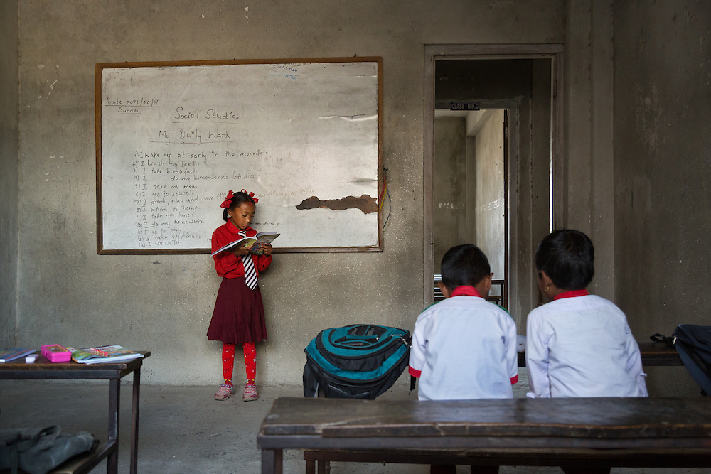 Kumari Dangol, 9, reads before other students during class. While the more prominent kumaris must never leave the house, local kumaris have fewer restrictions and are allowed to attend school.