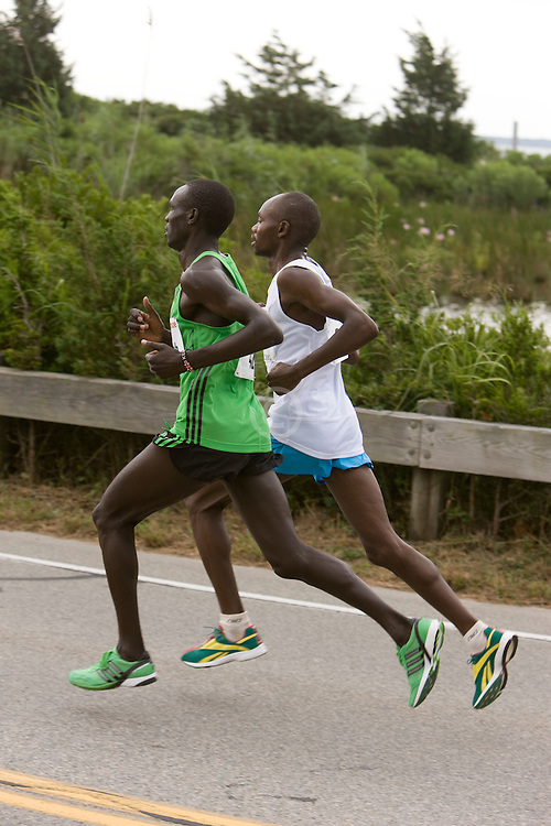 lead runners at mile three, Kogo, Rotich,