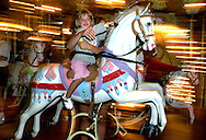 A young girl rides the merry-go-round on the Boardwalk, Wednesday, August 7, 2002, in Wildwood, New Jersey. (Photo by William Thomas Cain/photodx.com)