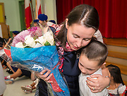 Claire Frazier hugs one of her students after being awarded the Chevalier dans Ordre des Palmes Academiques by France Cultural Attache Sylvie Christophe at Kolter Elementary School, November 20, 2013.