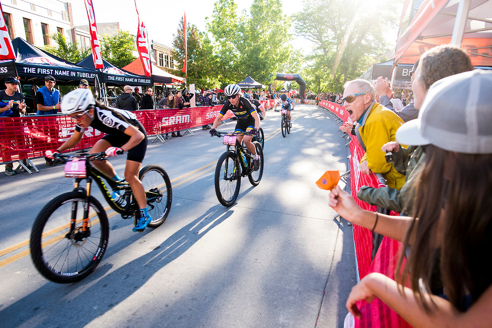 The crowd cheers racers on Pro Women's FateTire Crit.