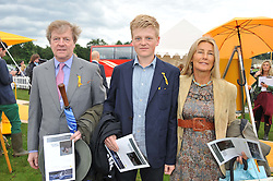 The HON.CHARLES & MRS PEARSON and their son GEORGE PEARSON at the 2012 Veuve Clicquot Gold Cup Final at Cowdray Park, Midhurst, West Sussex on 15th July 2012.