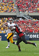 September 01 2012: Iowa Hawkeyes quarterback James Vandenberg (16) is hit by Northern Illinois Huskies linebacker Tyrone Clark (36) as he rolls out to pass during the first half of the NCAA football game between the Iowa Hawkeyes and the Northern Illinois Huskies at Soldiers Field in Chicago, Illinois on Saturday September 1, 2012. Iowa defeated Northern Illinois 18-17.
