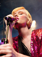 Young Woman Singing in Concert on stage low angle view close up