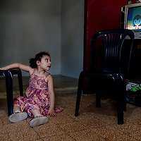 Khadijah watches TV in her small apartment in Beirut.<br /> <br /> Khadijah Moussa (6 years old) comes from a Syrian family composed of 7 members. They moved to Lebanon 5 years ago during the Syrian crisis for protection and survival. <br /> Khadija is one of 5 children, aged 6 years old and physically disabled.