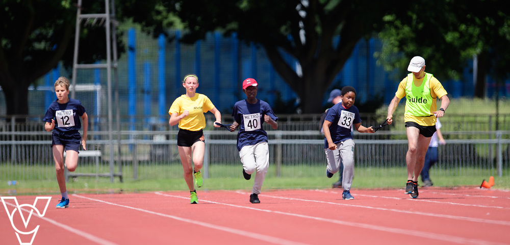 Metro Blind Sport's 2017 Athletics Open held at Mile End Stadium.  100m.  From left, Arthur Milles, Ebenezer Adu-Poku with guide runner and Clinton Njoku with guide runner<br /> <br /> Picture: Chris Vaughan Photography for Metro Blind Sport<br /> Date: June 17, 2017
