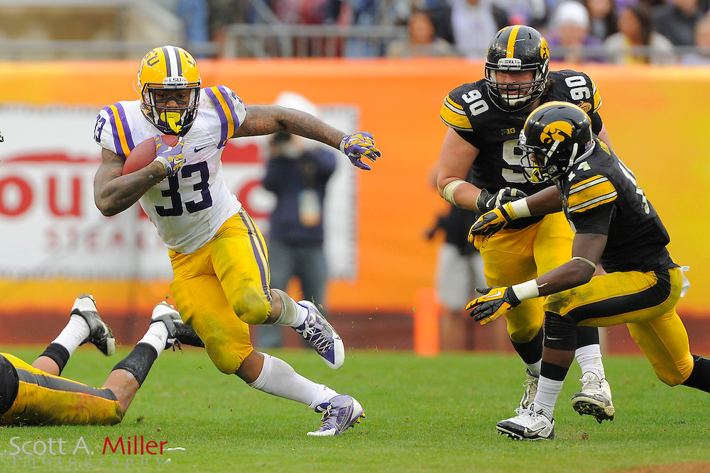 LSU Tigers running back Jeremy Hill (33) during LSU's 21-14 win over the Iowa Hawkeyes in the 2014 Outback Bowl at Raymond James Stadium on January 1, 2014 in Tampa, Florida.                                  <br /> <br /> &copy;2014 Scott A. Miller