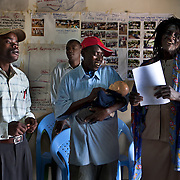 The Elwesero male support group acts out a comedic skit about breastfeeding and infant and young child nutrition. The HIV positive men in the group were trained in a workshop to learn the importance of exclusive breastfeeding and appropriate complementary feeding, as well as how to better support their partners. The men now educate, encourage, and support each other as part in an effort to engage men to increase support for optimal infant feeding in Western Kenya.