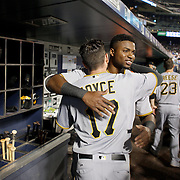 NEW YORK, NEW YORK - June 16: Gregory Polanco #25 of the Pittsburgh Pirates celebrates a home run from team mate Matt Joyce #17 of the Pittsburgh Pirates as he returns to the dugout during the Pittsburgh Pirates Vs New York Mets regular season MLB game at Citi Field on June 16, 2016 in New York City. (Photo by Tim Clayton/Corbis via Getty Images)