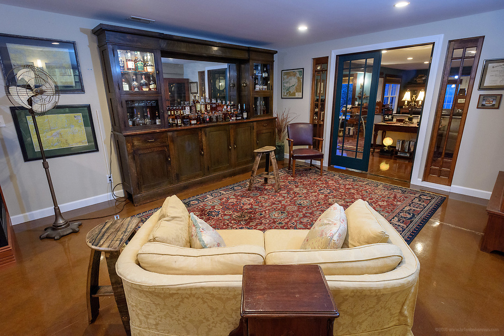 The bourbon bar in the lower level of the home of Kristen and David Embry in Pendleton, Ky. Feb. 22, 2018