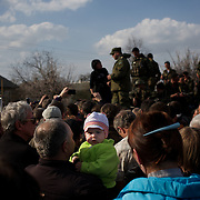 A column of Ukrainian men riding on armoured personnel carriers and tanks are blocked by pro-Russia activists in the eastern Ukrainian city of Kramatorsk, in the Donetsk region.