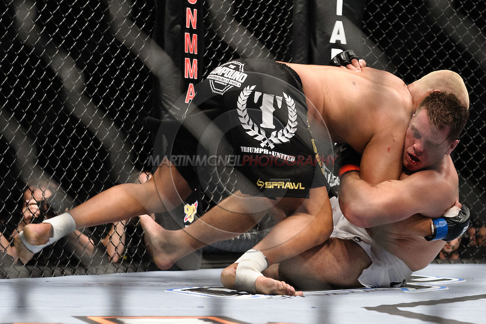 """LONDON, ENGLAND, JUNE 7, 2008: Eddie Sanchez (top) muscles Antoni Hardonk to the canvas during """"UFC 85: Bedlam"""" inside the O2 Arena in Greenwich, London on June 7, 2008."""
