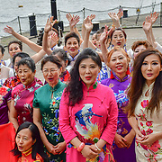 """Chinese Soprano 王蓓蓓,Wang Beibei (L) and  朱珍,Jane Maria sings 我和我的祖国,Me and my country to celebration of the 70th China National Day 2019 and a Chinese """"Qipao"""" flash mob, London, 28 September 2019, UK."""