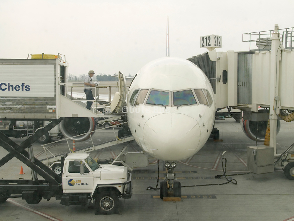 Front view of passenger jet airplane during refueling and refilling.