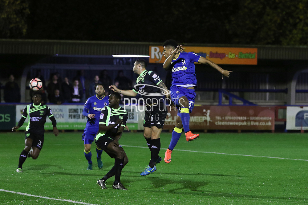 AFC Wimbledon striker Lyle Taylor (33) heads towards goal during the The Emirates FA Cup 1st Round Replay match between AFC Wimbledon and Bury at the Cherry Red Records Stadium, Kingston, England on 15 November 2016. Photo by Stuart Butcher.