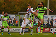 Forest Green Rovers midfielder Darren Carter (12) shoots at goal during the Vanarama National League match between Forest Green Rovers and Dagenham and Redbridge at the New Lawn, Forest Green, United Kingdom on 29 October 2016. Photo by Alan Franklin.