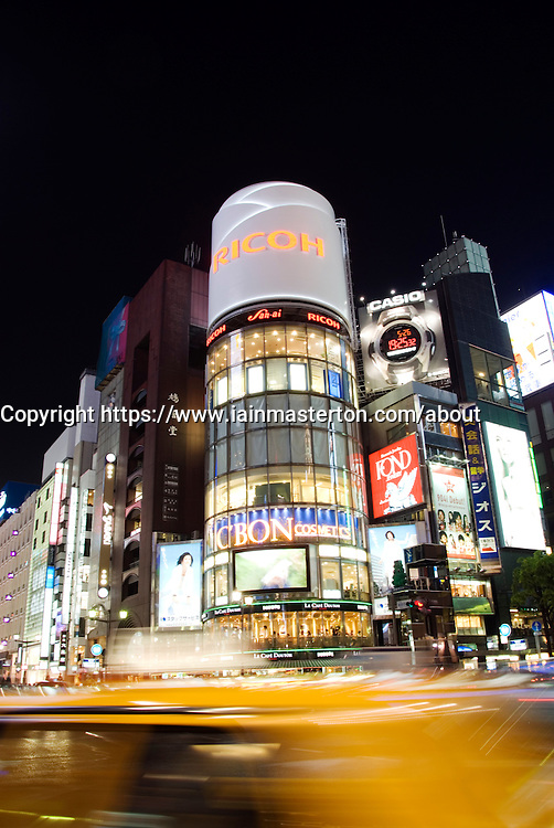 Evening view of buildings at street intersection at Ginza in Tokyo Japan