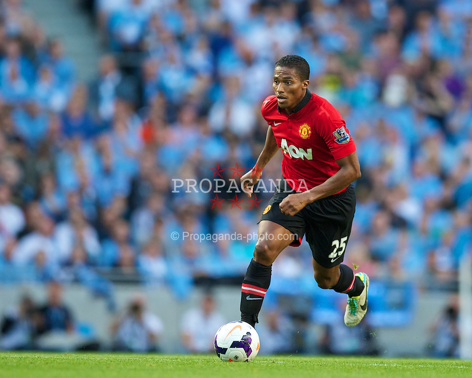 MANCHESTER, ENGLAND - Sunday, September 22, 2013: Manchester United's Antonio Valencia in action against Manchester City during the Premiership match at the City of Manchester Stadium. (Pic by David Rawcliffe/Propaganda)