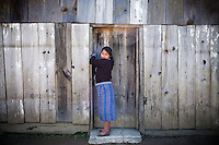 A young woman locks up a church in a remote village outside of Uspantan, Guatemala, on March 28, 2012. Many indigenous Guatemalans were accused by the government of harboring leftist guerrillas. Villagers here fled to the mountains where they lived for 12 years when the military came and burned their homes, raped the women and forced men into civic patrols.