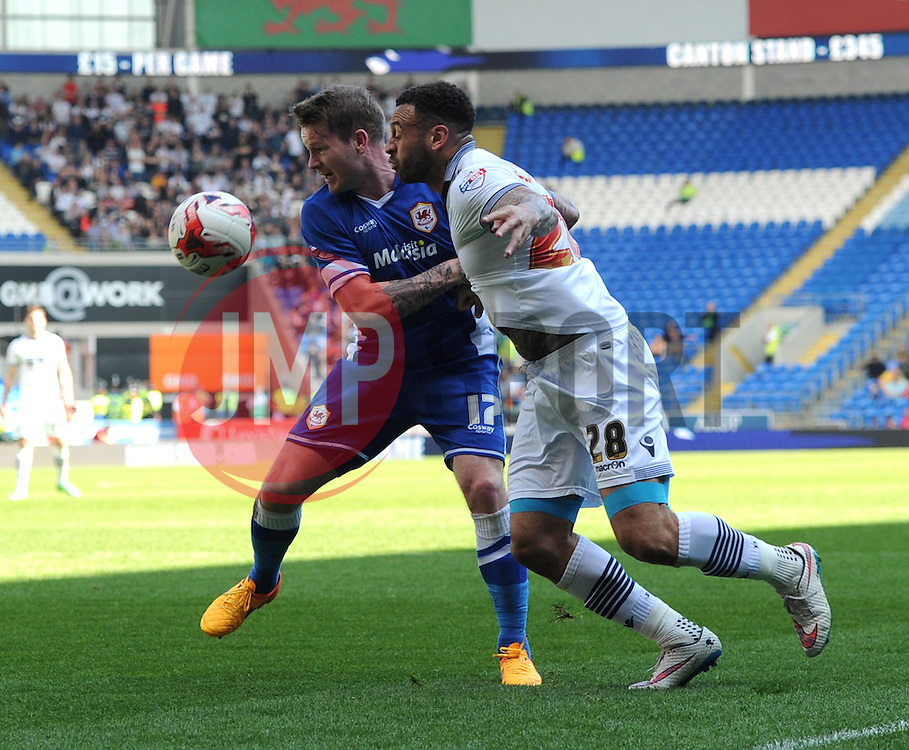 Cardiff City's Aron Gunnarsson and Bolton Wanderers' Craig Davies compete for the ball - Photo mandatory by-line: Paul Knight/JMP - Mobile: 07966 386802 - 06/04/2015 - SPORT - Football - Cardiff - Cardiff City Stadium - Cardiff City v Bolton Wanderers - Sky Bet Championship