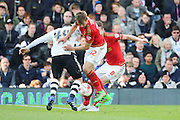 Nottingham Forest midfielder Robert Tesche (32) stopping Fulham Striker, Ross McCormack (44) during the Sky Bet Championship match between Fulham and Nottingham Forest at Craven Cottage, London, England on 23 April 2016. Photo by Matthew Redman.