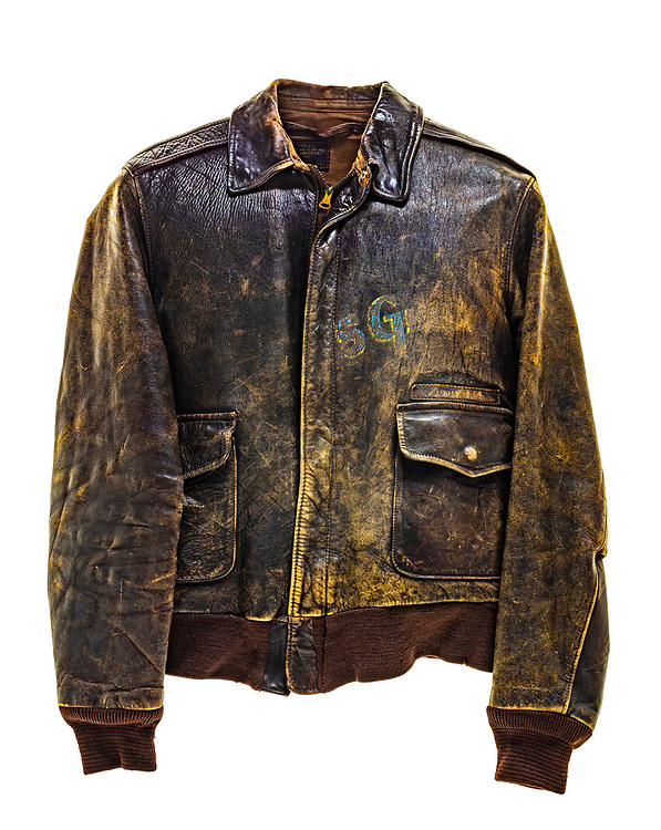 """This is a type A-2 flight jacket. This flight jacket would have been worn by a member of the 390th Bomb Group. This particular jacket does not have any art work on the back, squadron insignia on the front, or name plate to identify whose jacket it was, what squadron they were attached to, or which aircraft they flew. The letters """"SG"""" are painted in blue and yellow on the front of the jacket but are heavily faded."""