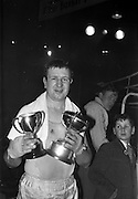 25/01/1963<br /> 01/25/1963<br /> 25 January 1963<br /> National Junior Boxing Championships at the National Stadium, Dublin. Picture shows M. Harris of St. Eugene's Boxing Club, Derry, the National Junior Light/Heavyweight Champion of Ireland 1963 with his trophy after he beat S. Irvine of Cooktown at the National Stadium.