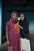 Two young Sidi girls stand together in a small community in central Ahmedabad exclusively occupied by Sidi families.
