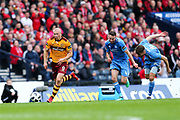 Curtis Main (#9) of Motherwell bursts clear of Andrew Considine (#4) of Aberdeen and K?ri ?rnason (#14) of Aberdeen to score Motherwell's third goal (3-0) during the William Hill Scottish Cup Semi-Final match between Motherwell and Aberdeen at Hampden Park, Glasgow, United Kingdom on 14 April 2018. Picture by Craig Doyle.