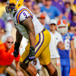 Oct 12, 2013; Baton Rouge, LA, USA; LSU Tigers defensive tackle Ego Ferguson (9) against the Florida Gators during the first half of a game at Tiger Stadium. Mandatory Credit: Derick E. Hingle-USA TODAY Sports