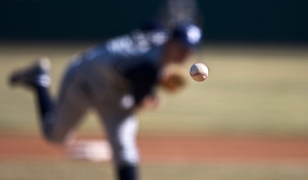 BYU Pitcher Jeremy Toole pitches to a Utah player in the Mtn. West Conference opener for both teams at Franklin Covey Field in Salt Lake City, Utah, Thursday, March 12, 2009.  August Miller, Deseret News .