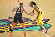 Los Angeles Sparks guard Chelsea Gray (12) attempts to dribble past Connecticut Sun guard Jasmine Thomas (5) during a WNBA basketball game, Friday, May 31, 2019, in Los Angeles.The Sparks defeated the Sun 77-70.  (Dylan Stewart/Image of Sport)