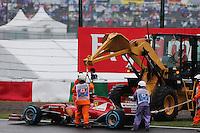 Marshals recover the Ferrari F14-T of race retiree Fernando Alonso (ESP) Ferrari with a digger.<br /> Japanese Grand Prix, Sunday 5th October 2014. Suzuka, Japan.