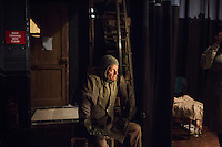 SLIEMA, MALTA - 8 FEBRUARY 2016: An actor waits backstage before entering the scene of touring Hamlet, performed by the Shakespeare's Globe theatre company, at the Salesian Theatre in Sliema, Malta, on February 8th 2016.<br /> <br /> The touring Hamlet, performed by the Shakespeare's Globe theatre company, is part of the Globe to Globe tour that set off in April 2014 (on the 450th anniversary of Shakespeare's birth) with the ambitious intention of visiting every country in the world over 2 years. The crew is composed of a total of sixteen men and women: four stage managers and twelve twelve actors  actors perform over two dozen parts on a stripped-down wooden stage. So far Hamlet has been performed in over 150 countries, to more than 100,000 people and travelled over 150,000 miles. The tour was granted UNESCO patronage for its engagement with local communities and its promotion of cultural education. Hamlet was also played for many dsiplaced people around the world. It was performed in the Zaatari camp on the border between Syria and Jordan, for Central African Republic refugees in Cameroon, and for Yemeni people in Djibouti. On February 3rd it was performed to about 300 refugees in Calais at the camp known as the Jungle.