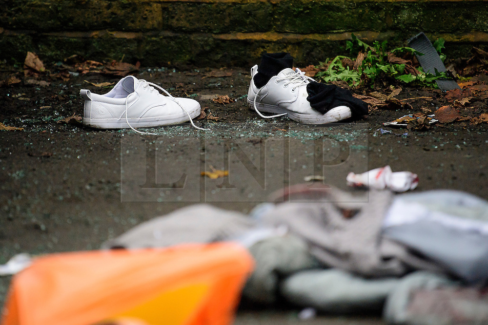 © Licensed to London News Pictures. 12/12/2016. London, UK. Bloodied materials and shoes on the ground where a person was thrown over the railing of a bridge when a Ferrari sports car ploughed in to a group of pedestrians in Battersea, South London. Photo credit: Ben Cawthra/LNP