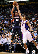 Mar. 1, 2013; Phoenix, AZ, USA; Atlanta Hawks guard John Jenkins (12) shoots  the ball against the Phoenix Suns forward Wesley Johnson (2) in the first half at US Airways Center. Mandatory Credit: Jennifer Stewart-USA TODAY Sports