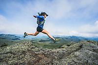 Rebecca Coryea running from the summit of Mount Marcy, Adirondacks, New York,