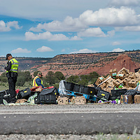 New Mexico State Police investigate the scene where debris lay scattered across 1-40. A semi-tractor trailer that was traveling on the eastbound lane crossed over into westbound lane, resulting in a collision with a Greyhound bus traveling to Los Angeles, CA. The incident occurred in Thoreau, NM Thursday afternoon. The accident killed at least seven people, according to New Mexico State Police.
