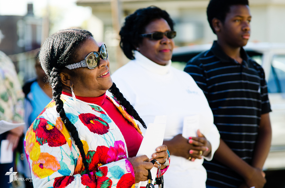 College Hill resident Ella Strickland listens to a welcome during the LCMS Prayer & Praise Walk on Friday, Oct. 17, 2014, in the College Hill neighborhood of St. Louis. LCMS Communications/Frank Kohn