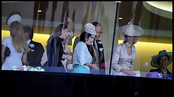 Princesses Beatrice and Eugenie and the Queen (sitting down Purple Hat) in the Royal Box after the queens winning horse Estimate wins the Gold Cup with her horse at Royal Ascot 2013 Ascot, United Kingdom,<br /> Thursday, 20th June 2013<br /> Picture by Andrew Parsons / i-Images