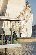 Two ladies on a cafe close by the Discoveries monument in Belém district, in Lisbon.