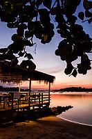 Deck do Restaurante Porto do Contrato na Praia do Ribeirão da Ilha ao anoitecer. Florianópolis, Santa Catarina, Brasil. / Deck of Porto do Contrato Restaurant at Ribeirao da Ilha Beach at dusk. Florianopolis, Santa Catarina, Brazil.